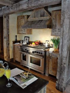 Love the rustic cabinets and great stove!