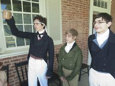 Thomas Stevenson, left, 14, of Beechwood Village, portraying Nicholas Croghan, Oliver Graves, center, 12, of Hunting Creek, portraying Edmund Croghan, and Noah Heiner, 15, portraying Charles Croghan, raise a patriotic toast at the Independence Day celebration at Locust Grove. July 4, 2014 ... Louisville,    Kentucky