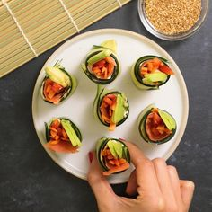 These gluten-free cucumber sushi rolls are so easy to make and they are such a colorful and pretty appetizer. Filled with fresh veggies and a seasoned cream cheese. Great for summer! Cucumber Sushi Rolls, Veggie Sushi Rolls, Sushi Roll Recipes, Vegetarian Sushi Rolls, Vegetarian Recipes, Cooking Recipes, Healthy Recipes, Bite Size Appetizers, Appetizers For Summer