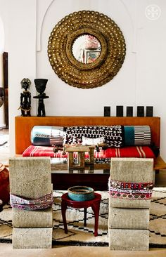 Exotic African designs -living room  concrete shapes as coffee table  could be interesting!