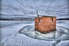 custom made ice fishing shanty on a frozen lake