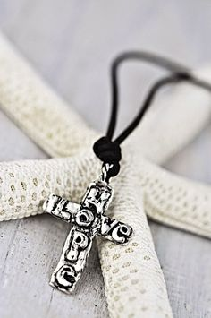 """Love Hope Necklace - This awesome rustic cross has """"love"""" and """"hope"""" etched onto the front. It is strung on a chocolate leather cord. www.islandcowgirl.com #faith #hope #crossnecklace #islandcowgirl"""