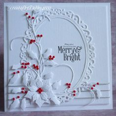 handmade Christmas card from A Scrapjourney ... one of Debby's favorites ... I luv it too!! ... white on white with die cuts including Starbinders holly, poinsettia and lacey fram ... bright red beads as holly berries and flower center ...