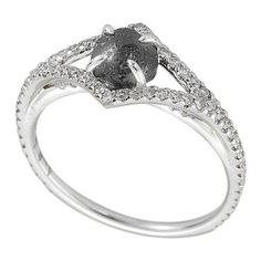 Victorian Black Diamond Ring. The centerpiece of this romantic Victorian-style white gold ring is a 1.26 carat black rough diamond.