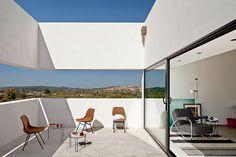 that balcony. Villa Extramuros In Arraiolos, Alentejo by Vora Arquitectura | Yatzer