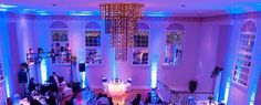Blue uplighting with tall ceilings | Rent online for $19/each + free shipping both ways nationwide at www.RentMyWedding.com/Rent-Uplighting