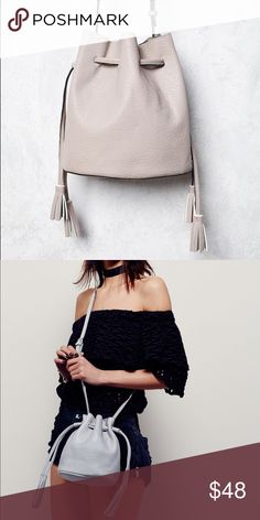 Free People Bleeker Bucket Bag Free People. 'Bleeker' Bucket Bag. Retail: $68. Color is light gray, almost cream. This super sleek and textured versatile bucket bag is featured in a soft vegan leather with a drawstring closure and tassel accented ends. Softest faux suede lining! Adjustable buckle strap. Can be worn as a shoulder bag or a cross-body. New without tag condition. No flaws. 🛍20% Off Bundles of 2+ Items! Free People Bags Satchels