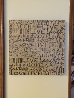 Wall art made from a canvas, scrapbook paper and Mod Podge.