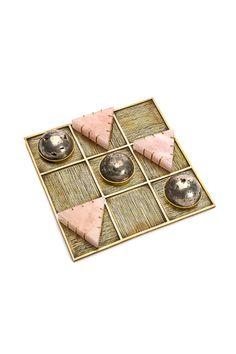 Kelly Wearstler tic tac toe set in 14k gold, rose quartz, and pyrite.  Each set is handcrafted by artisan jewelers. Xk #kellywearstler