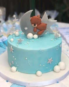 How cute is this Moon Bear baby shower cake? Covered with fondant and coloured, decorated with dagrees, modelling paste balls and a Moon & Bear which are all edible. Torta Baby Shower, Baby Shower Pasta, Baby Shower Cakes For Boys, Baby Boy Cakes, Shower Baby, Babyshower Cake Boy, Baby Showers, Boys First Birthday Cake, Baby Birthday Cakes