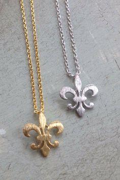 Fleurty Girl - Everything New Orleans - Mini Fleur de Lis Necklace, $10. A brushed metal fleur de lis on a 16 inch chain. Fleur de lis 1/4 of an inch high.