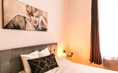 Marilyn will kiss you good night after you Parisian Day.  http://www.it.halldis.com/property/square-petrelle-80553#dateFrom=01032016&dateTo=06032016