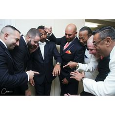 The groom and groom guys having a great time on their wedding day. Nyc Photographer New York Wedding Photographer
