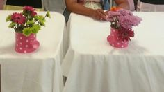 Watering can centerpieces for April Showers bring May Flowers baby shower.