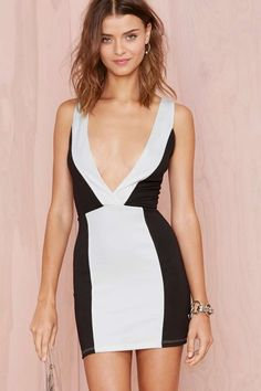 Take the plunge in this black bodycon dress with contrast white panels, a plunging V-neckline, and a V at back.