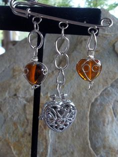 Heart Locket with a surprise surrounded by by RoseFireDesigns, $22.00
