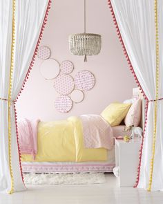 A precious pink and yellow pastel bedroom by Serena & Lily!