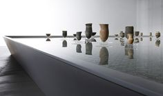 Tadao Ando designed the exhibition, featuring a pool of water on which the ceramics float. Lucie Rie, Jennifer Lee and Ernest Gamperi exhibition