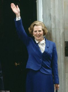 Power dressing: Margaret Thatcher waves to the crowds outside 10 Downing Street after her election victory