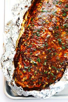 Absolutely LOVE this Honey Mustard Salmon recipe! It only takes about 25 minutes, it can be made on the grill or baked in the oven, and it's made with the most delicious (gluten-free!) sauce. | gimmesomeoven.com