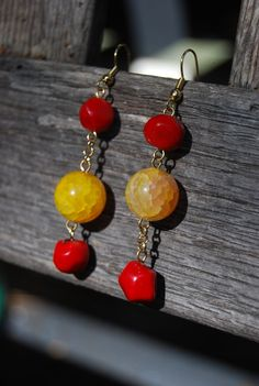 Red Coral & Yellow Agate Mismatched Drop Earrings. $29.00, via Etsy.