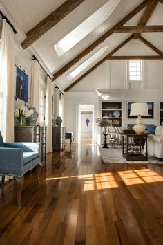 White walls and wood beams. Beautiful blue accents. HGTV Dream Home 2015