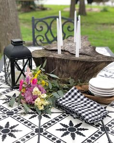 In this post I'm sharing how I updated an old tile table for the outdoors.How to update an old outdoor table, stencilling a table top, tile stencil ideas, update an old table, update old tile Tile Patio Table, Tile Tables, A Table, Outdoor Tiles, Outdoor Rooms, Outdoor Living, Outdoor Furniture, Christmas Table Settings, Christmas Decorations