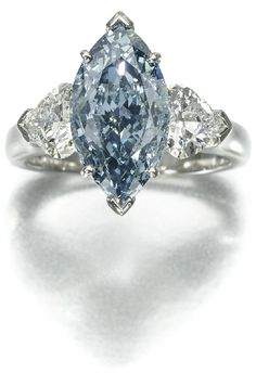 Graff fancy deep blue diamond, and diamond ring. Set at the centre with a fancy deep blue marquise-shaped diamond weighing 2.07 carats, between heart-shaped diamond shoulders, size 47, signed Graff, case.   Accompanied by GIA report no. 11332187, stating that the diamond is Fancy Deep Blue, Natural Colour, VS2 Clarity.