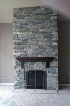 Echo Ridge Country Ledgestone by Boral Cultured Stone with wood mantel
