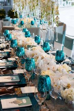 Love the turquoise glasses! Not for were table cause that's a lot, but atleast for the bridal party
