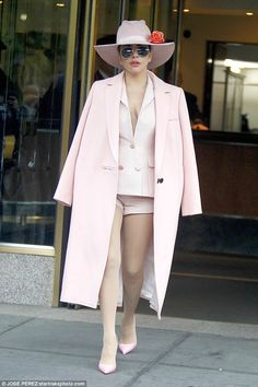 She's a Material Girl! Lady Gaga mimics Madonna's style as she suits up in New York on Friday... after saying they were not alike