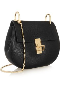 The It Bag  A Worthy Investment  ELLE Editors Discuss   handbags     Black textured leather  Lamb   sand suede  Calf  Pin and clasp