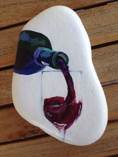 Pintura em pedra More - Crafting TodayUnusual painted rock, wine bottle poured into wine glass.Making craft rocks with some DIY easy rock painting ideas can be a really fun activity to do with your kids. The main activity will be rock painting which Rock Painting Patterns, Rock Painting Ideas Easy, Rock Painting Designs, Wine Painting, Pebble Painting, Pebble Art, Pebble Stone, Painting On Stones, Painting Art
