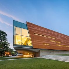 Gould+Evans+adds+vibrant+orange+skin+to+Brutalist+library+in+Kansas