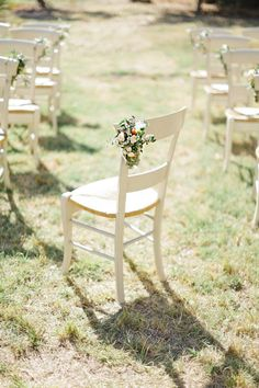 simple, elegant floral design on the ceremony chairs  Photography by xaviernavarro.com, Event Design and Planning by lucytillfrenchweddings.com
