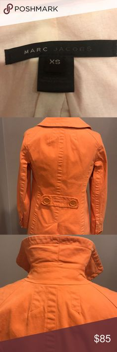 EUC MARC JACOBS TANGERINE ORANGE CHINO TRENCHCOAT I ABSOLUTELY ADORE THIS TRENCH BY MARC JACOBS . WORN A HANDFUL OF TIMES - AND RECEIVED COMPLIMENTS EACH AND EVERY TIME. MADE OUT IF 💯 percent cotton - this trench is MACHINE WASHABLE!! Great sideways pockets on the front of coat and my favorite- THE EXTRA LARGE BUTTONS THAT REALLY LOOK AMAZING BUT ALSO COVER EASY TO CLOSE SNAPS! THIS IS A CLASSIC MARC JACOBS AND HAS THAT HINT OF FUN! Marc Jacobs Jackets & Coats Trench Coats