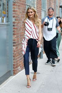 red irregular stripped long top and cropped navy pants,strappy sandals. Classy style- Olivia Palermo