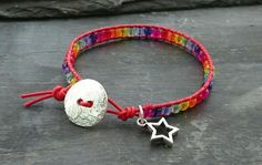 Red leather and rainbow glass bead bracelet with silver button and star charm £10.00