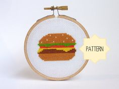 Nom, nom, nom! This little cheeseburger looks good enough to eat!    The perfect size to adorn your kitchen walls or even sit jauntily on your desk,