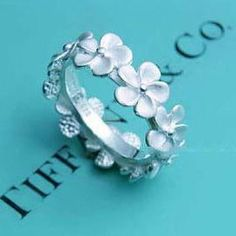 Forget me not ring by, Tiffany and Co. Would love it more if it was gold Bling Bling, The Bling Ring, Jewelry Box, Jewelry Accessories, Jewlery, Gold Jewellery, Tiffany Jewellery, Daisy Jewellery, Tiffany And Co Jewelry