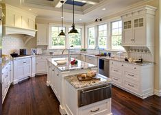 White cabinets, subway tile, wood floor, couldn't ask for more :)