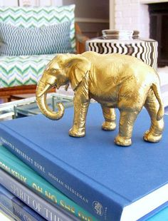 Cheap toy elephant spray painted gold