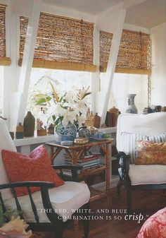 Love this Design of the seating area in a living room or sunroom & the mix of textures & styles. Love the bamboo shades.  red + white + blue