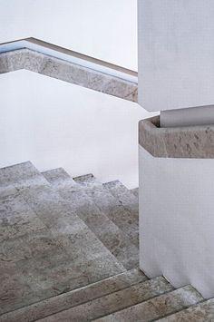 Stone staircase handrail detail.