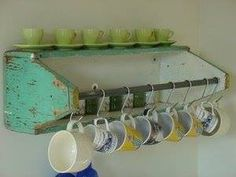 Old wooden tool box used for kitchen shelf, mug rack