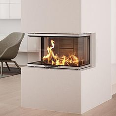 The Rais Visio 3 Three Sided Inset Fireplace has a output and can be placed in a setting where view of the glass on 3 sides is needed. See this fireplace in our showroom in Belper. Inset Log Burners, Inset Stoves, Inset Fireplace, Modern Fireplace, Basement Fireplace, Bbq Wood, Charred Wood, Wood Burner, Living Room Inspiration