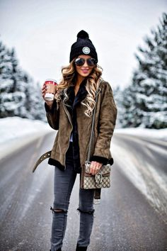 fashion blogger mia mia mine wearing a shearling topshop jacket and a herschel black hat from nordstrom
