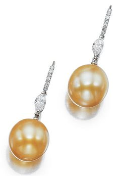 Pair of Golden Cultured Pearl and Diamond Pendant-Earrings 18 kt. white gold, topped by slender diamond-set curved bands joined by 2 marquise-shaped diamonds approximately .70 ct., suspending 2 golden pearls.