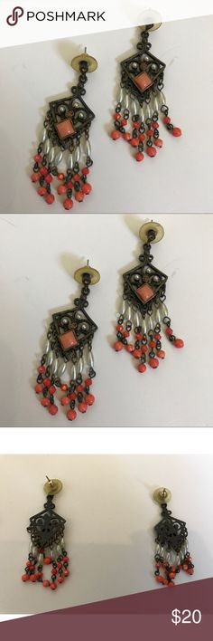 Vintage Dark Metal Orange Pink Beaded Earrings. Really pretty Vintage hanging Earrings. Pentagon shaped out of dark old school metal style base. Completed with a couple orange rhinestones, Faux pearls, and pink and orange beads. Super cute, classic, unique earrings. Pair these with just about anything. Jewelry Earrings