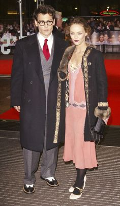 A Look Back At Johnny Depps Iconic Style: 2004: Here is a rare instance of Depp wearing a tie, albeit a bright red one.